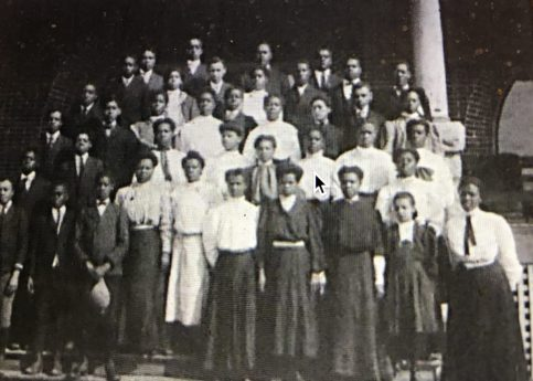 """Sallie Phillips was one of the first students at the Brick School, in Edgecombe County, N.C., a pioneering institution that provided a vision of """"liberty and the larger life"""" for thousands of African American children in eastern NC between 1895 and 1933. This photograph shows the school's students in 1909. From """"The Bricks School Legacy,"""" a documentary film by Dr. Willa Cofield (2003)."""