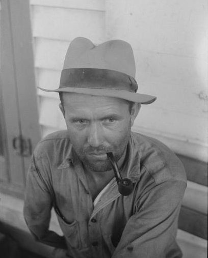 A migrant laborer from Texas at the potato grading station in Belcross, N.C. He was making 20 cents at hour. According to Jack Delano, the man dreamed of having his own sweet potato farm one day. Courtesy, Library of Congress