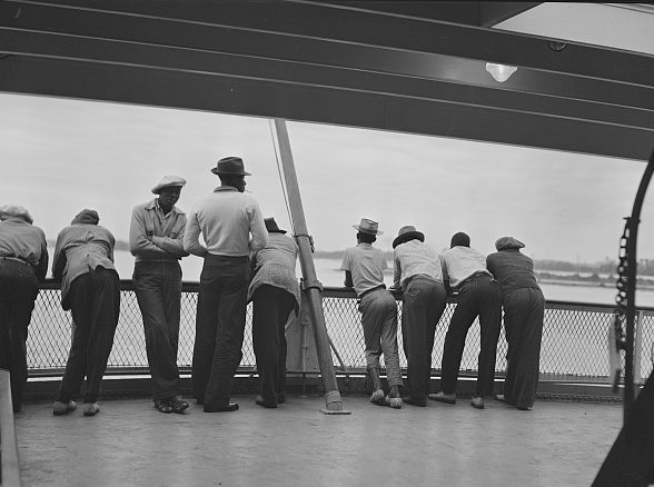 On the Norfolk-Cape Charles ferry, 1940. This group of migrant workers had finished the potato harvest in Camden County, N.C., and were headed to a new job on the Eastern Shore of Virginia. Photo by Jack Delano. Courtesy, Library of Congress