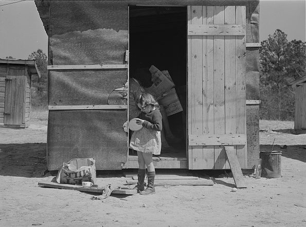 Near Fayetteville, N.C., 1941. This young girl's family rented this little shack for $5 a week while her father worked at Fort Bragg. Photo by Jack Delano. Courtesy, Library of Congress