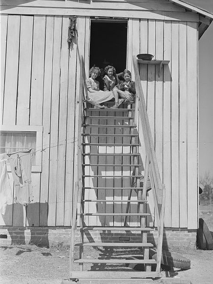 Near Fayetteville, 1941. Children sitting on the stairs of their home on the 2nd story of a tobacco barn. Photo by Jack Delano. Courtesy, Library of Congress