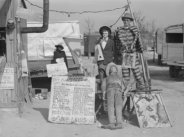 "The ""Crime Museum"" was one of the traveling tent shows that followed the construction workers to the Fayetteville area. Jack Delano, the photographer, described the tent show's owner as ""an old shell-shocked World War veteran."" Courtesy, Library of Congress"