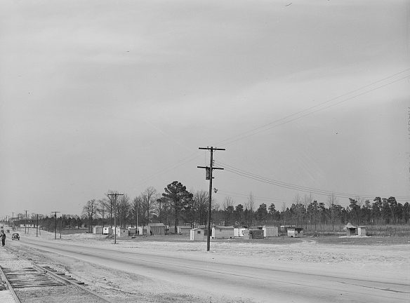 View of camp of Ft. Bragg construction workers and their families on the Fayetteville-Ft. Bragg road, 1941. Photo by Jack Delano. Courtesy, Library of Congress