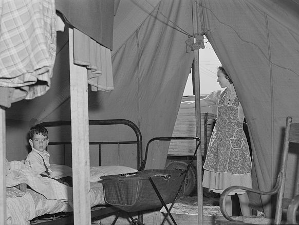 Migrant camp near Fayetteville, N.C., 1941. This family traveled all the way from South Texas so that this woman's husband could get work at Ft. Bragg. Photo by Jack Delano. Courtesy, Library of Congress