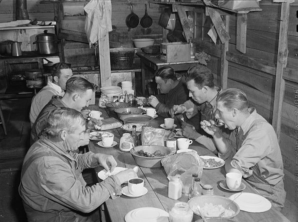 Migrant construction workers eating supper at a trailer camp near Fayetteville, N.C., 1941. Photo by Jack Delano. Courtesy, Library of Congress