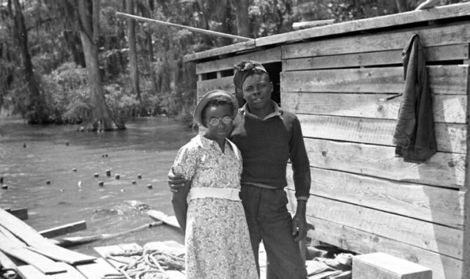 Young couple probably at the Terrapin Point fishery, located where in the Cashie River, the Roanoke & Albemarle Sound come together in Bertie County, N.C., ca. 1937-39. Photo by Charles A. Farrell. Courtesy, State Archives of North Carolina