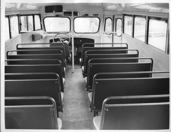 Interior of a Hackney-built school bus, 1930s. My cousin Edsel used to drive a school bus like this in the 1930s. He was an imp when he was a kid (and hadn't changed much when he was 90!). He once told me that he sometimes intentionally got the bus stuck in the mud. He'd get all the kids off the bus so the older boys could push the bus out of the mud. Meanwhile he and his pal would rifle through the better-off kids' lunch boxes and take the good stuff! Photo courtesy, NC Collection, Barton College