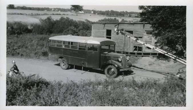 This is one of the few photographs of rural scenes in eastern N.C. that I found in the collection: this is a school bus from Charles L. Coon High School in Wilson that overturned next to what looks like a sharecropping family's cabin on a rural dirt road in the countryside. Many of the company's buses served rural communities like the one shown here. Courtesy, NC Collection, Barton College
