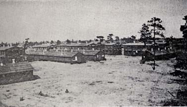 """Barracks built at Fort Bragg, N.C., 1918-19. At the time, a pamphlet reported that, because of the labor shortage, """"the contractors were forced to obtain labor from foreign fields, such as the Mexicans, Porto Ricans, Spaniards, Cubans, and even, in some cases, the Asiatic races."""" From Camp Bragg and Fayetteville: Sketches of Camp and City"""