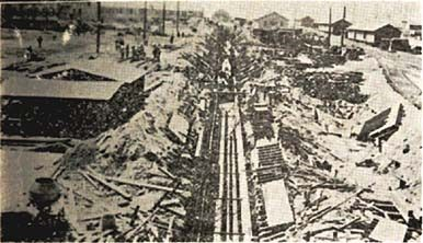 Sewage line under construction, Fort Bragg, N.C., 1918-19. Just to get building supplies to the center of the base, workers had to clear a wide swath of forest for several miles. Hundreds of mule teams then hauled piping, lumber and other materials along that route until better roads and railroad lines were built. From Camp Bragg and Fayetteville: Sketches of Camp and City (Richmond, Va.: Central Pub. Co., 1919).