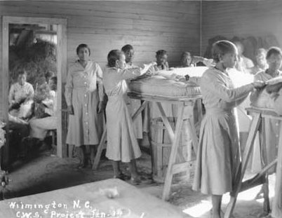 An Emergency Relief Administration (ERA) pine straw mattress factory in Wilmington, N.C., ca. 1934. The ERA was a predecessor of the WPA. Courtesy, State Archives of North Carolina