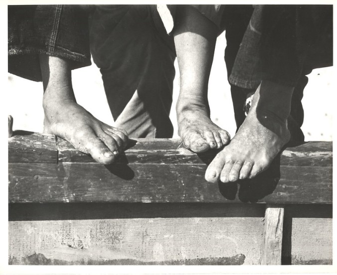 Mullet fishermen's feet, Bald Head Island, N.C., 1938. Photo by Charles A. Farrell. Courtesy, State Archives of North Carolina