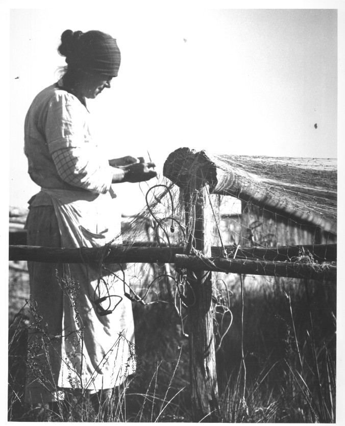 She lived at Poverty Point, where she was not the only woman that mended nets to help her family get by. Photo by Charles A. Farrell. Courtesy, State Archives of North Carolina