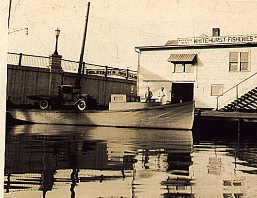The Whitehurst fish house and one of the family's fishing tugs on the Vermilion River in Vermilion, Ohio, ca. 1930-48.