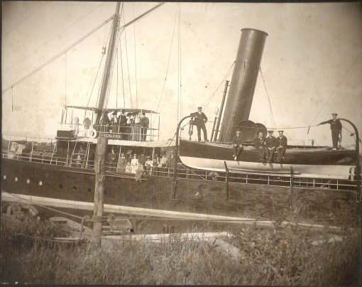 The steam yacht Peerless when Tom Pigott was her captain and Giles Whitehurst was her first mate or engineer, place unknown, ca. 1900 to 1915. Courtesy, Giles Willis, Jr.