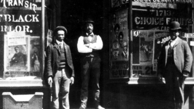 Migrants from southern states were swelling Brooklyn's black population by 1898, but there had been a free black settlement in the city since before the Civil War. Located in what's now Crown Heights, Weeksville was known as for its anti-slavery activism, its role in the Underground Railroad and its black businesses, including the shop in this photograph. Courtesy, Weeksville Heritage Center