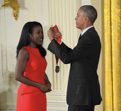 In Black Wide-Awake, Lisa Y. Henderson reflected on Wilson's black migrants to New York City in a post dedicated to Isabel Wilkerson's magnificent book on the Great Migration, The Warmth of Other Sons: the Epic Story of America's Great Migration. Wilkerson is pictured here receiving the National Humanites Medal from Pres. Obama in 2015. Courtesy, Susan Walsh/AP